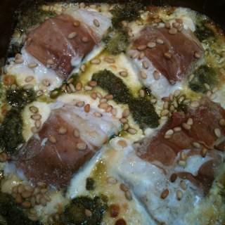 Prosciutto and pesto fish gratin