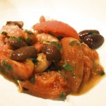 Buttered prawns with tomato, olives and arak