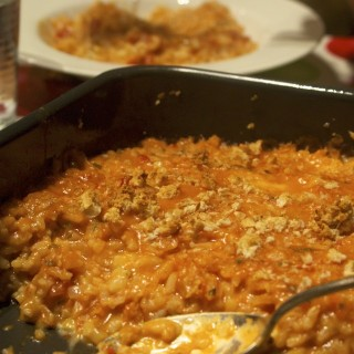 Ever so cheesy baked risotto with tomato and mozzarella