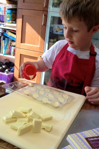 Pouring white chocolate into egg moulds