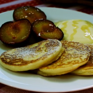 Sticky griddled plums and pancakes