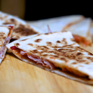 Cheese, ham and tomato quesadillas