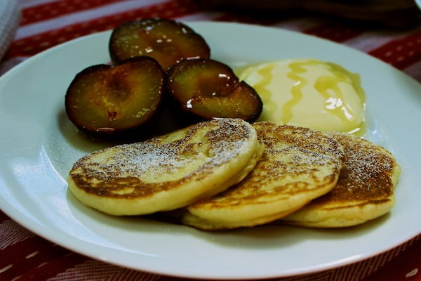 American style pancakes with sticky grilled plums