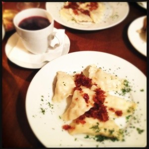 Beetroot soup and plates full of pierogi