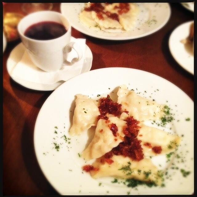 Beetroot soup and plates full of pierogi - photo by Ren Behan