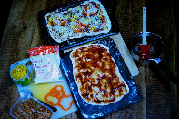 Making barbecue turkey pizza