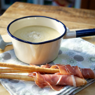 Parsnip soup with parma ham breadsticks