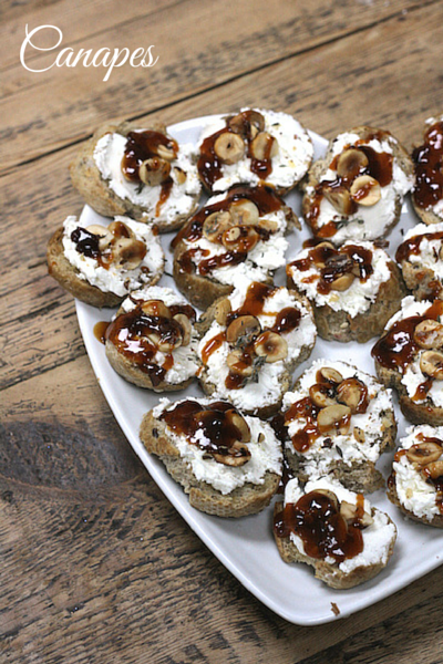 canapes - goats cheese toasts with hazelnuts and chilli honey