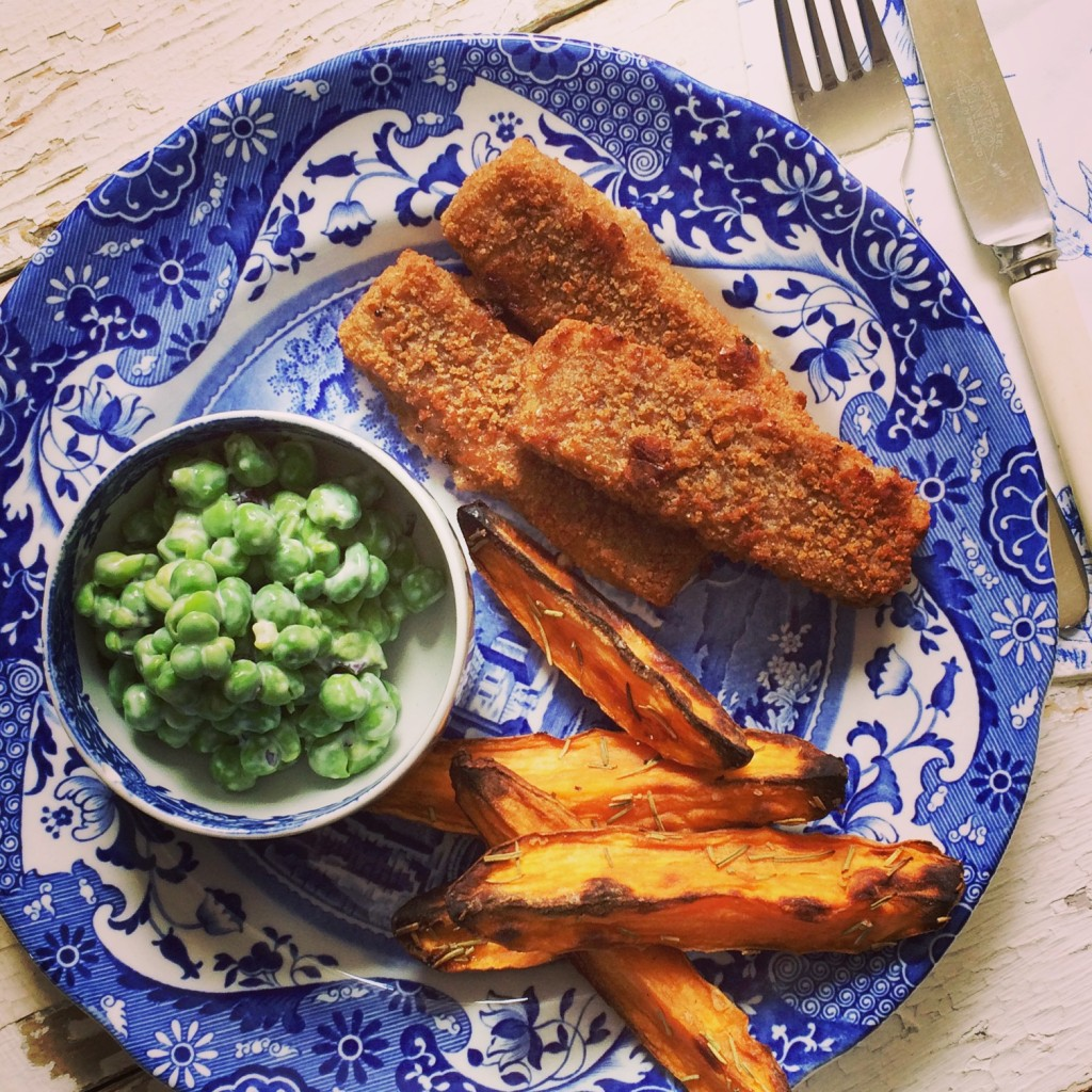 Wholegrain fishfingers, sweet potato wedges and crushed minted peas