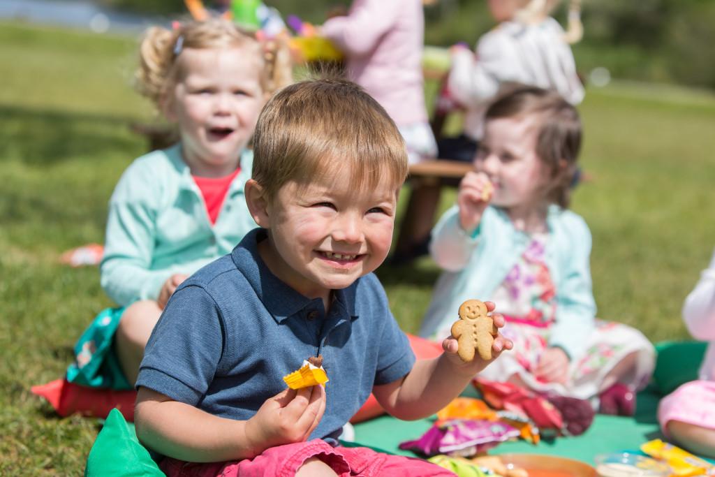 Children tucking into Organix Goodies snacks