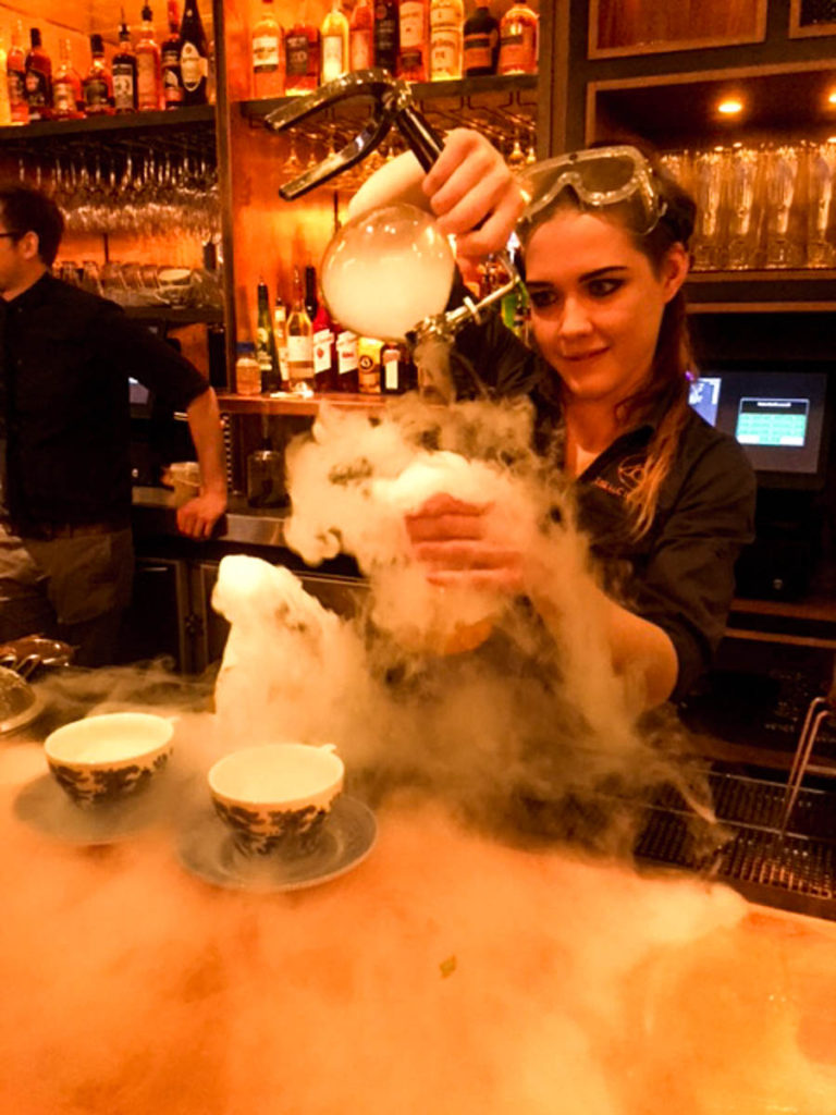 Mixologist creating The Mad Hatters at The Alchemist Newcastle